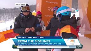trending snowboarding coach knitting at top of slope nbc