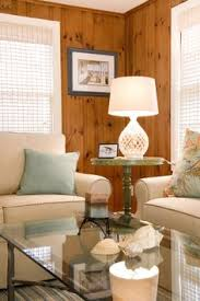 updated knotty pine room with white furniture window treatments
