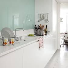 kitchen splash guard ideas kitchen with modern glass splash back in a galley kitchen white