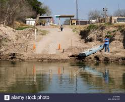 people walking to the ferry landing at los ebanos tx usa photo