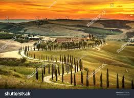 Light And Landscape - tuscany rural sunset landscape countryside farm stock photo