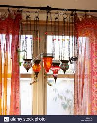 Sari Fabric Curtains Up Of Mosaic And Glass Moroccan Lanterns On Window With