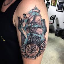 grey ink nautical compass and ship on left half sleeve