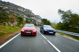xe lexus ct 200h 2015 bmw 335i m sport vs jaguar xe s head 2 head comparison motor trend