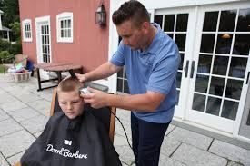 bringing haircuts to you doorbell barbers makes house calls