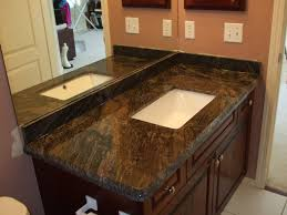 white granite countertop with round white sink over brown wooden