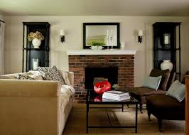 brick fireplace with mirror above and lovely wall sconces