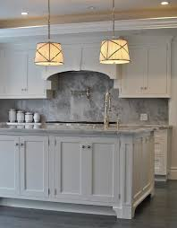 white kitchen cabinets with gray marble backsplash transitional
