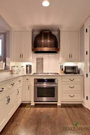 copper kitchen cabinets copper kitchen hood transitional kitchen blake shaw homes