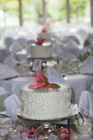 small cake centerpieces at a wedding reception stock photo