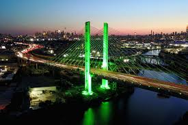 cities light up green in support of climate agreement curbed