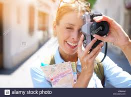 portrait tourist taking picture architectural details stock