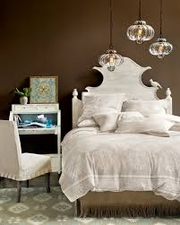 dark paint color inspiration for your room how to decorate brown walls behind a whitewashed wooden headboard from ballard designs catalog