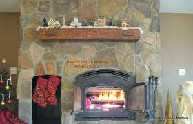regaling rustic wood mantel shelf along with wood fireplace