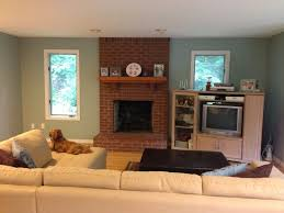 magnificent living room paint colors with red brick fireplace digs