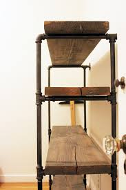 Distressed Wood Shelves by Shelves Made From Plumbing Pipes Fitted Pieces And Distressed Wood