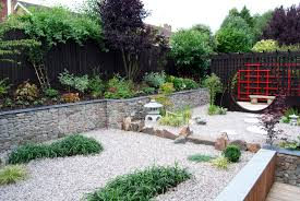 outdoor living rock japanese garden design with fish pond and