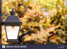 a weathered copper porch light on a bright fall day stock photo
