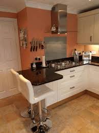 small kitchen with breakfast bar white granite countertop red