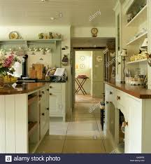 fitted dresser and pale cream fitted units in country kitchen with