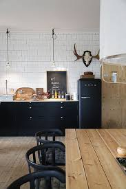 modern scandinavian design black cabinets and chairs white tile