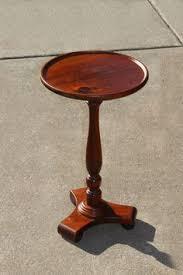 vintage pedestal side table antique hand carved hardwood table porcelain caster wheels a