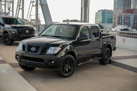 new nissan truck nissan adds new titan and frontier midnight edition models the