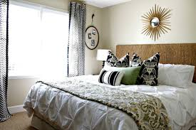inspiring guest bedroom with metal bed frame also light green