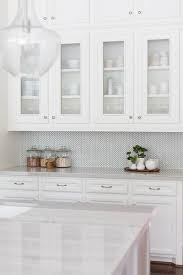 ann sacks kitchen backsplash white and gray kitchen features white cabinets paired with new