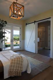 bedroom brown chandeliers brown wooden floor white matresses