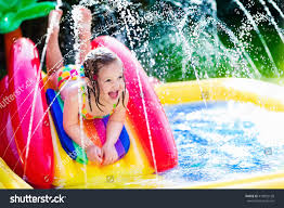 children playing inflatable baby pool kids stock photo 419032198