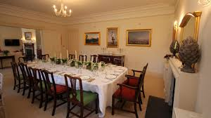 stately holiday home for let near aberdeen scotland the bright and inviting dining room is full of ancestral pictures
