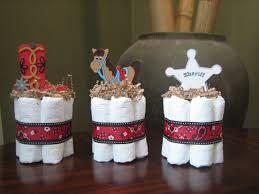 three cowboy mini cakes for baby shower decoration