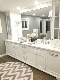 master bathroom traditional master bathroom with footed cabinetry and herringbone