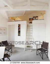 stock photo of metal ladder staircase to mezzanine bedroom in
