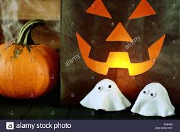 scary halloween party background with a glowing paper bag stock