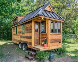 mini homes this tiny farmhouse will make you want to downsize asap cedar