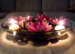 bowl filled with lotus and floating candles for wedding
