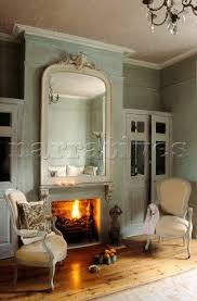 pe001 01 open fire in soft blue grey living room with
