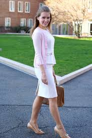 white belted peplum dress with pink cardigan skirt the ceiling