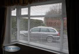 metal venetian blinds in a square bay window harmony blinds of