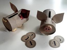 toy piggy bank made from a toilet paper roll a frozen dinner box