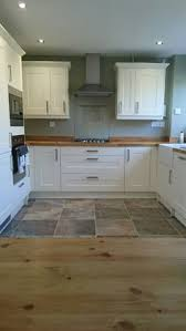 Cream Shaker Kitchen Cabinets by I Love The Wood Countertops And The Coat Hooks On The Side Of The