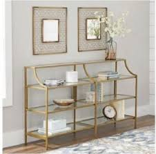 slim console table gold metal glass display shelves living room