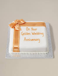 celebration sponge cake with gold ribbon m u0026s