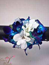blue orchid corsage blue and white orchid wrist corsage cherry blossoms florist