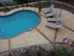 stamped concrete around inground pool round designs
