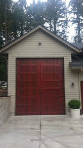 bi fold carriage style garage door and rv port portland or