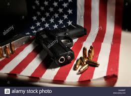 A American Flag Pictures A Ruger 9mm Pistol With An American Flag Is Owned By An American