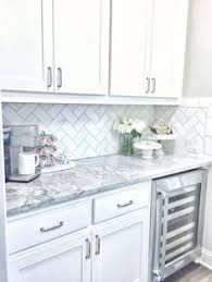 Backsplash With White Kitchen Cabinets Marble Countertops Herringbone Subway Backsplash House Decor